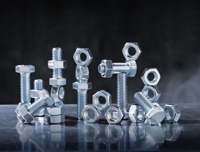Close-up of nuts and bolts on table