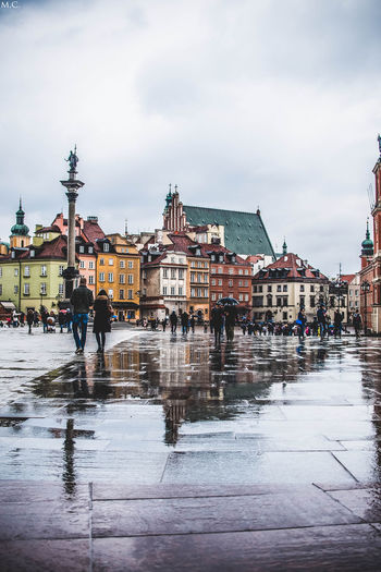 Reflection of buildings on wet street in rainy season