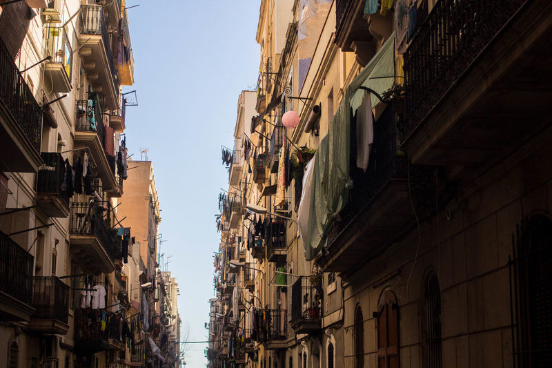 Apartment Buildings Barcelona Streets Catalonia Catalunya Old Town Urban Lifestyle Apartment Apartments Architecture Balcony Building Exterior Built Structure City Clear Sky Day Linen Low Angle View Narrow Street No People Outdoors Residential Building Residential District Residential Structure Sky Urban