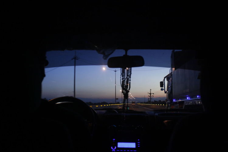Car Car Interior City City Life Driving Glass - Material Illuminated Land Vehicle Mode Of Transport On The Move Road Sky Street Traffic Transportation Travel Windshield