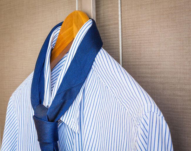 Close-up of shirt hanging on window