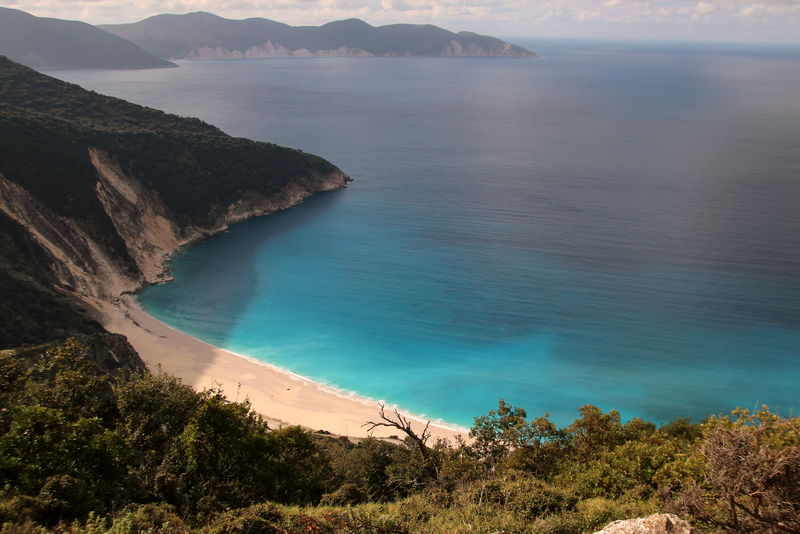 Myrtos Beach Beach Beauty In Nature Cephalonia Cephalonia Cliff Day Greece Greek Islands High Angle View Idyllic Landscape Mountain Myrtos Beach Nature No People Outdoors Scenics Sea Sky Tranquil Scene Tranquility Travel Destinations Tree Water