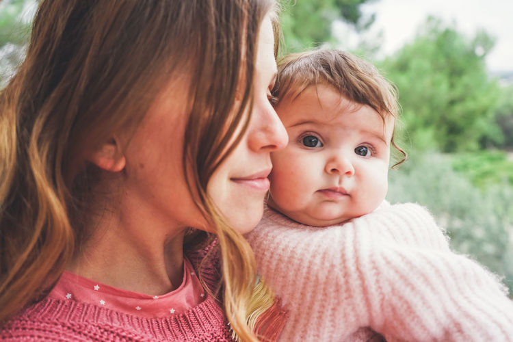 Portrait of mother and baby girl