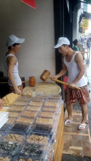 They are doing cookies with big wooden mallet and singing. @humanofzjut
