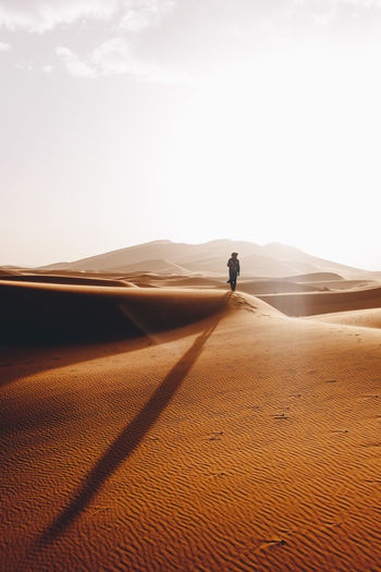 Man on desert against sky