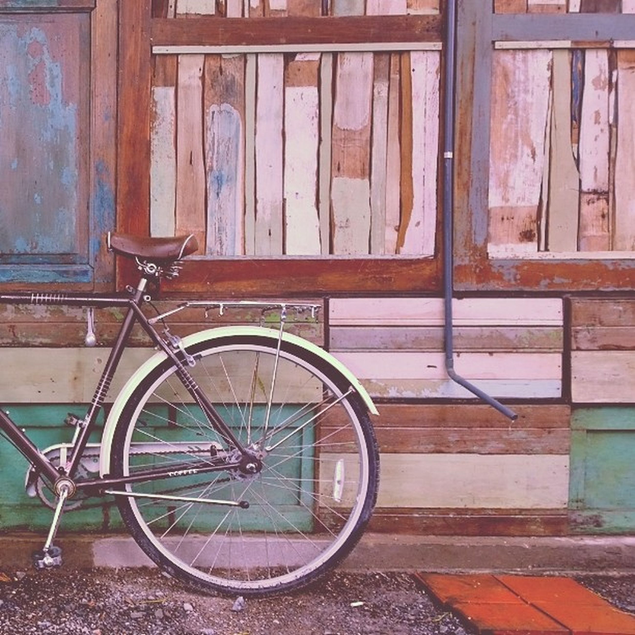 bicycle, built structure, wood - material, architecture, building exterior, metal, stationary, old, mode of transport, parked, window, wall - building feature, house, day, door, no people, transportation, wheel, outdoors, wooden