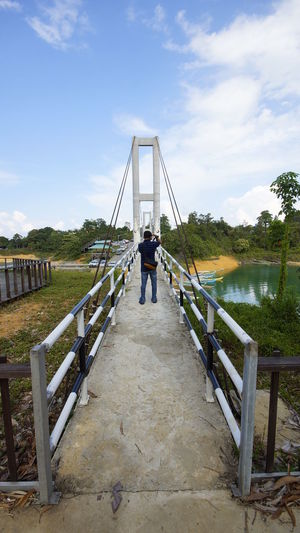 wonderfull nature and boat view at lake Architecture Bridge Bridge - Man Made Structure Built Structure Cloud - Sky Connection Day Diminishing Perspective Direction Footbridge Full Length Lifestyles Men Nature One Person Outdoors Railing Real People Rear View Sky The Way Forward Water