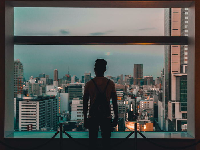 over Shibuya Japan Japan Photography Tokyo Tokyo Street Photography Shibuya Silhouette People One Man Only Vintage Moments Urban City Lost Adrift Moody Colorful Cityscape Cityscape Urban Skyline light and reflection The Architect - 2017 EyeEm Awards The Portraitist - 2017 EyeEm Awards An Eye For Travel