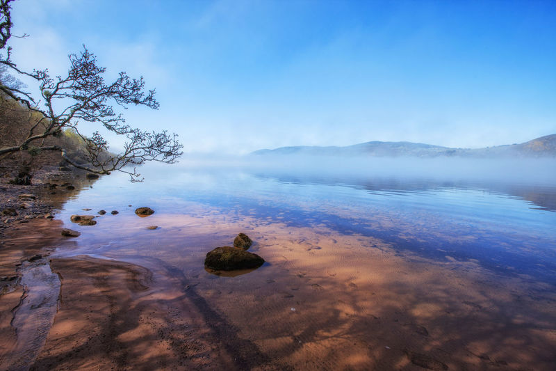 Early morning at Loch Ness lake, Scotland, UK Beach Beauty In Nature Blue Day Fog Over Water Foggy Foggy Morning Horizon Over Water Lake Lakeshore Loch  Loch Ness Lochness Nature No People Outdoors Reflection Sand Scenics Scotland Sea Sky Tranquil Scene Tranquility Water