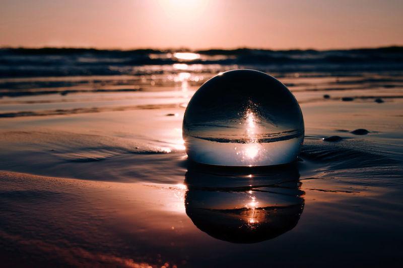 Crystal ball on the beach during sunrise