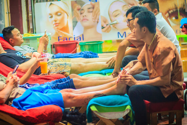 Bangkok, Thailand - March 2, 2017: Foot massage service in spa salon at Khao San Road night market, Bangkok, Thailand. Khao San Rd Khao San Road KhaoSan Khaosan Rd. Khaosandroad Tourist Tourist Attraction  Tourists Adult Boys Casual Clothing Child Childhood Females Foot Massage Foot Massage Foot Massage Area Friendship Group Of People Khao San Khao San Knok Wua Khao San Rd. Khaosan Road Khaosanroad Leisure Activity Lifestyles Looking Males  Men Night Market Night Market In Thailand Night Market, People Real People Seat Selective Focus Sitting Togetherness Tourist Destination Women