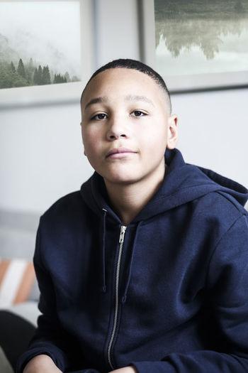 Portrait of teenage boy sitting outdoors