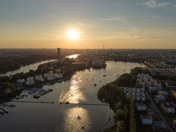 Above Rummelsburger Bucht Drone  Aerial View Architecture Beauty In Nature Building Exterior Built Structure City Cityscape Day Dronephotography Droneshot High Angle View Horizon Over Water Nature No People Outdoors River Scenics Sky Skyscraper Sun Sunlight Sunset Travel Destinations Water Discover Berlin
