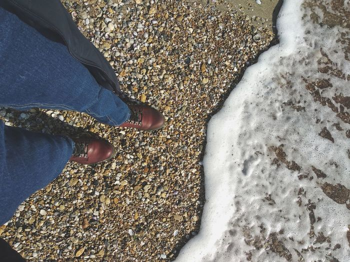 Sea Seaside Beach Wave Foam Boots Sand Sunny Day Jeans Low Section Standing Human Leg Shoe High Angle View Human Foot Close-up Pebble Beach