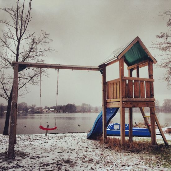 Architecture Beauty In Nature Berlinwinter Built Structure Cold Temperature Day Lake Nature No People Outdoors Playground Sky Snow Swing Tree Tristesse Winter Winter
