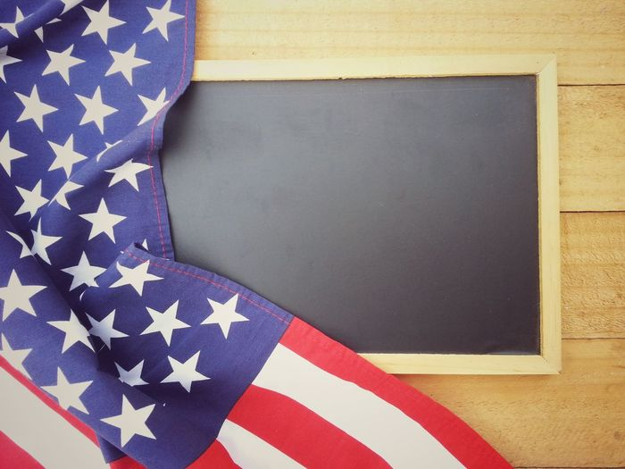 Blackboard for text and american flag on old wood table Memorial Day USA Remember Country America Greeting Celebrate Celebration Event Nation Flag Independence Soldier Holiday Patriotism Anniversary Memorial Liberty Pride Army Peace Memory Peaceful Cheerful 4th Of July