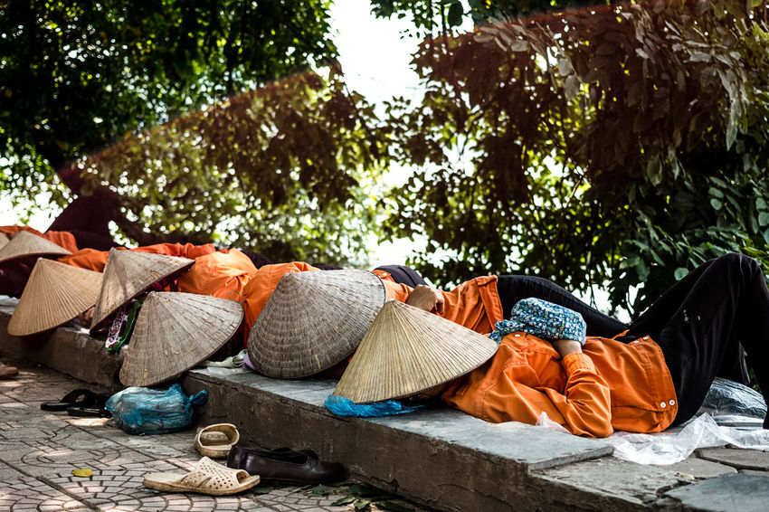 A well-deserved nap around Hoan Kiem lake in Hanoi | Vietnam. ASIA Colors Day Hanoi Hoan Kiem Lake Nap Nature Orange Outdoors People Real People Textile The Street Photographer - 2017 EyeEm Awards Tired Tree Vietnam Working