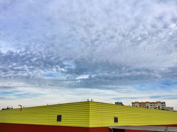 Low angle view of house against cloudy sky