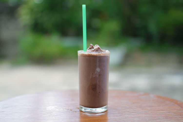 Close-up of iced coffee on table