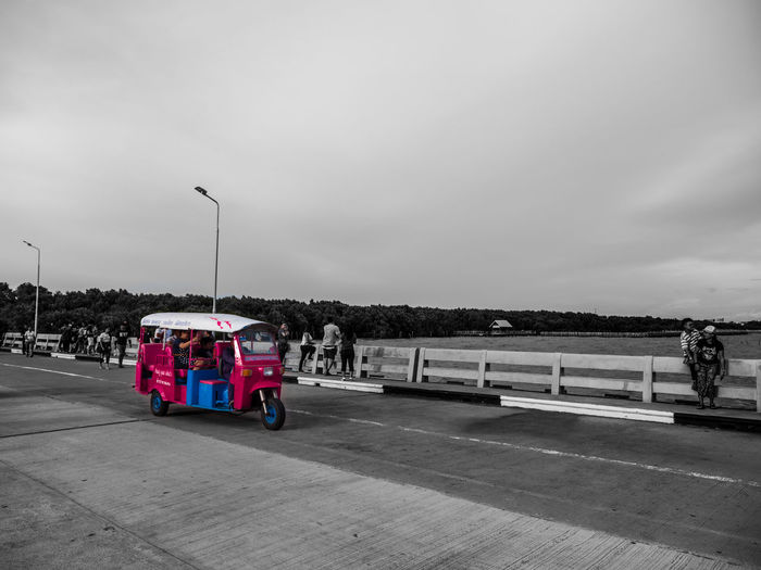 The pink Tuk Tuk in Bangpu area. Hightlight Pier Pink Travel Tuk Tuk In Bangkok TukTuk Bridge Day Group Of People Large Group Of People Men Nature Outdoors People Real People Road Sky Street Light Transportation Tuk Tuk