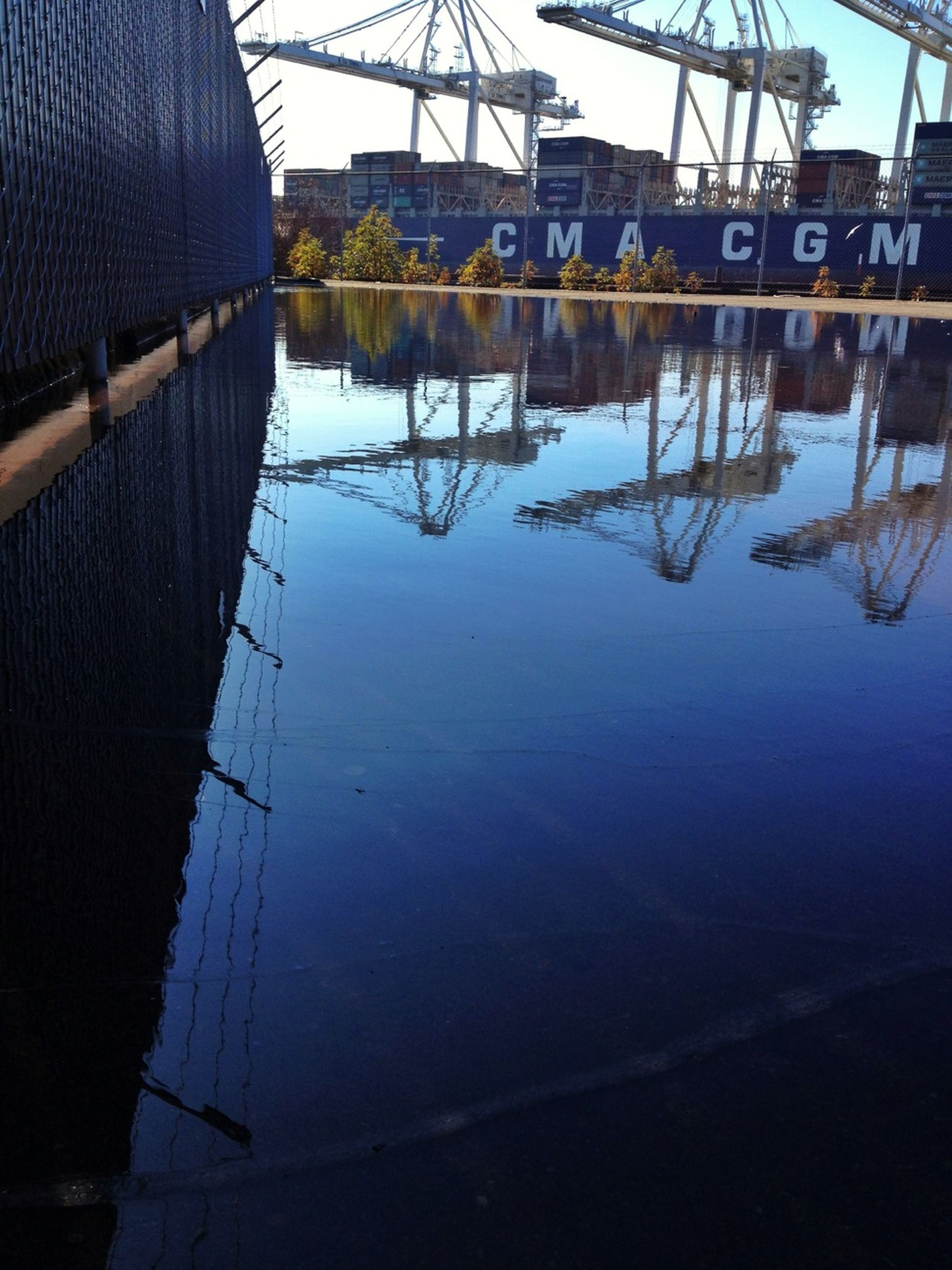 water, reflection, built structure, architecture, building exterior, nautical vessel, transportation, sky, river, lake, moored, boat, waterfront, mode of transport, outdoors, standing water, connection, day, no people, harbor