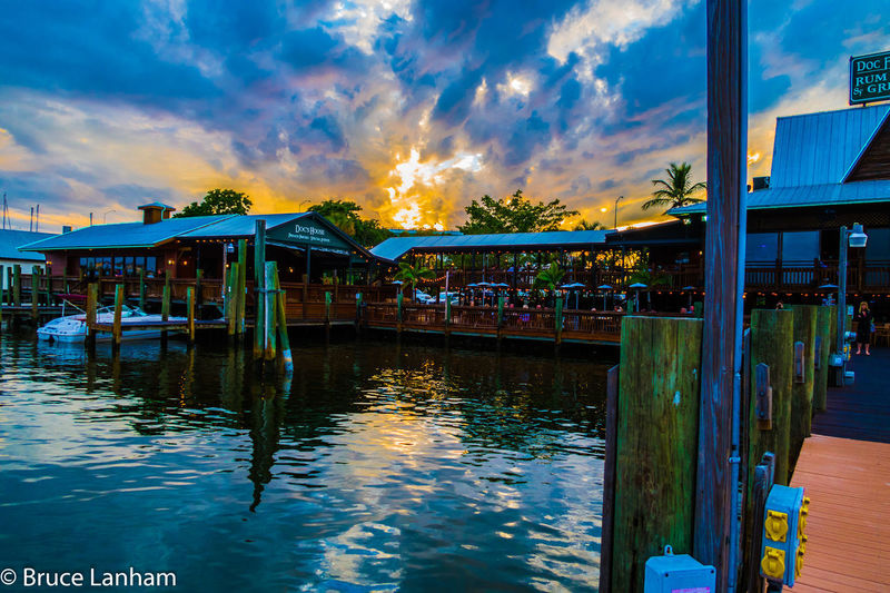 View in San Carlos harbor off Fort Myers Beach Fort Myers Beach Harbor Margaritaville Rum Architecture Beauty In Nature Building Exterior Built Structure Cloud - Sky Day Nature Nautical Vessel No People Outdoors Reflection Sky Sunset Water