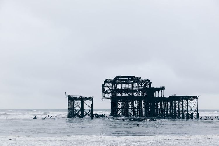 West Pier On Sea Against Clear Sky At Brighton