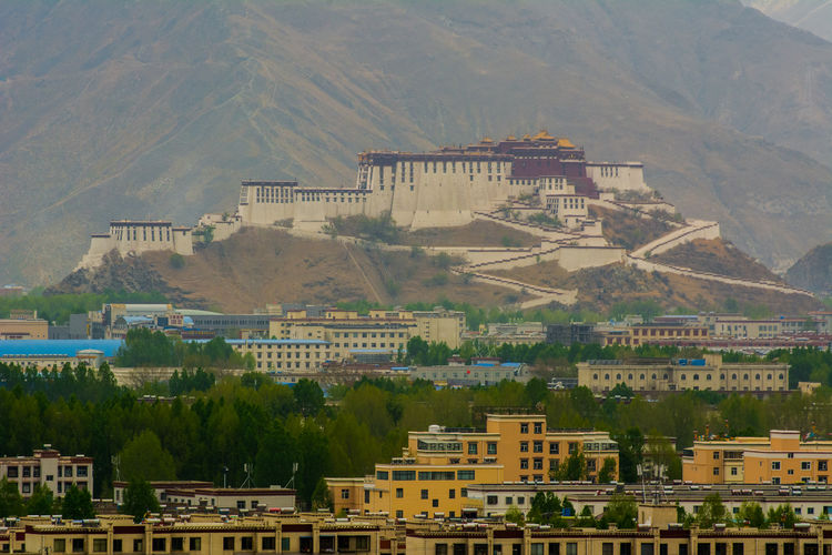 Potala Palace Lhasa, Tibet Potala Palace Potala Palace, Tibet, China Tibet Travel Architecture Beauty In Nature Building Building Exterior Built Structure China City Cityscape Environment Landscape Lhasa Mountain Nature Potala Palace And Surroundings Tibet Travel Destinations