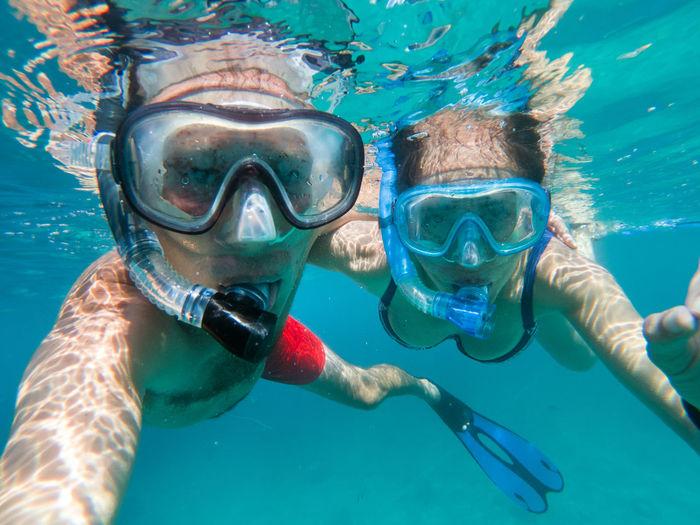 Portrait of people swimming undersea