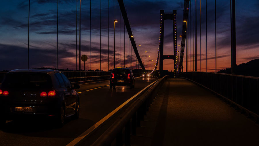 Sunset of Askøy bridge Transportation Mode Of Transportation Cloud - Sky Sky Sunset Motor Vehicle Illuminated Land Vehicle No People The Way Forward Car Connection Direction Architecture City Nature Bridge Travel Road Dusk Bridge - Man Made Structure Outdoors Electricity