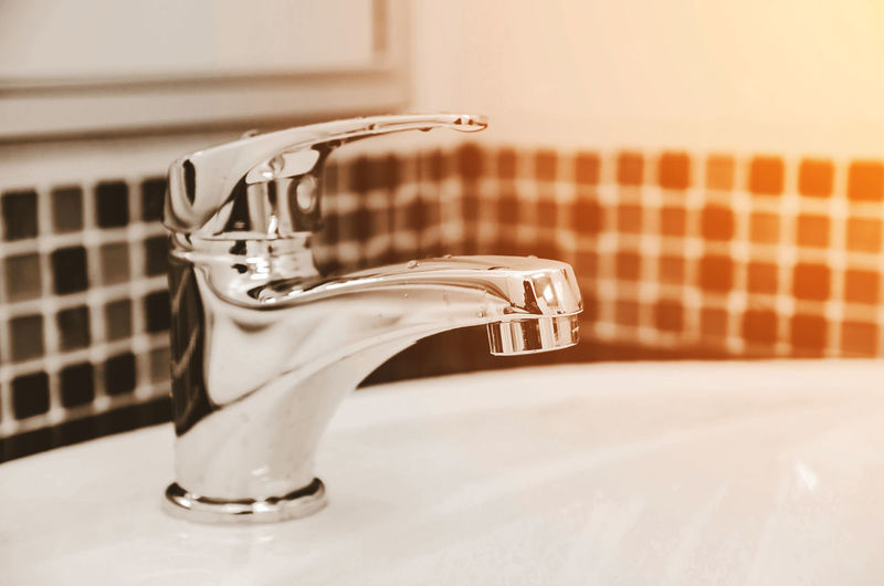 Close-up of water faucet at home