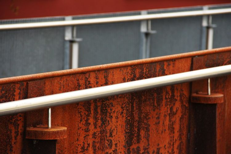 High angle view of metal railing against wall