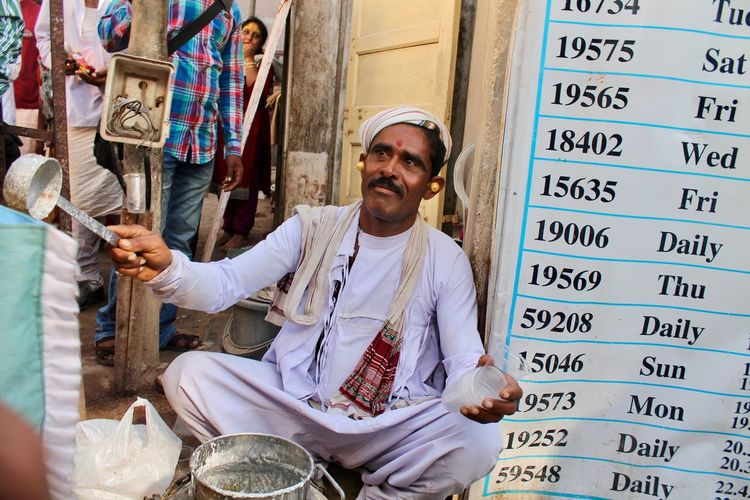 Adult Adults Only Beard Business Finance And Industry City Day Dwarka Holding Lifestyles Looking At Camera Market Stall Market Vendor Mature Adult Men One Man Only One Mature Man Only One Person Only Men Outdoors People Portrait Real People Smiling