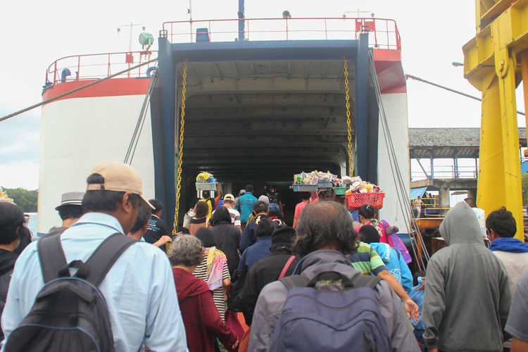Going Home Travel Travel Photography Trip Boat Crossing Sea Crowd Day Journey Large Group Of People Lifestyles Men Outdoors People Protestor Real People Rear View Ship Togetherness Women