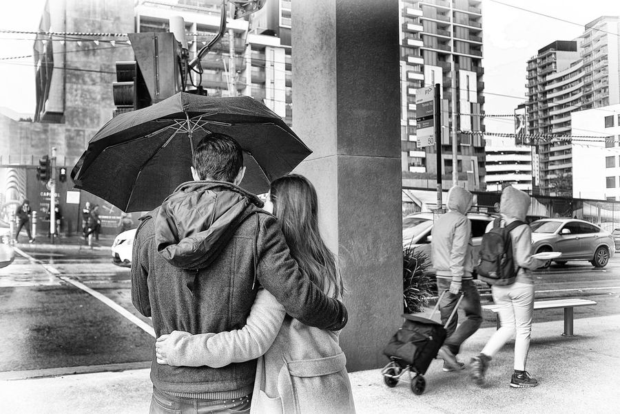 Blackandwhite Bonding City Life City Street Couples Embracing Leicacamera Love Loving Couple Partners Raining Rainy Day Street Togetherness Umbrella Walking Warm Clothing