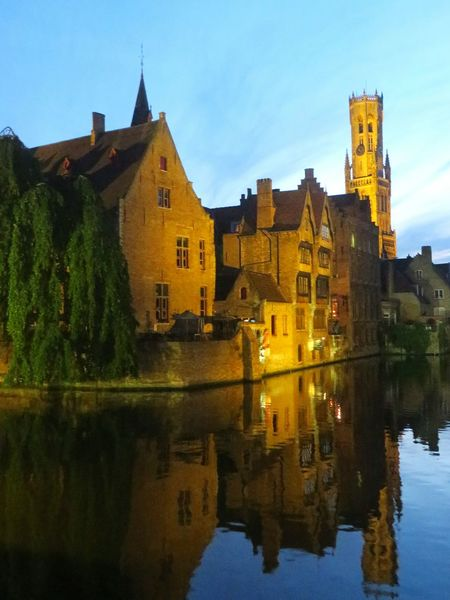 As usual I forgot to bring my tripod with me 😅 Architecture Reflection Blue Clear Sky Travel Destinations Famous Place History Tourism Night View Nightphotography Old Town Sightseeing Brugge Picsartrefugees Brüggesehenundsterben River Reflection Architecture Tranquility Bruges Travel Sky Nightview Nightshot