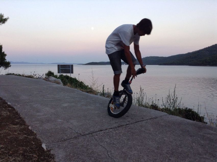 Miss summer sports Side View Lifestyles Men Sea Outdoors Sky Sunset Croatia Unicycle Unicyclist  Unicycle Tricks Sport Throwback The Street Photographer - 2017 EyeEm Awards The Street Photographer