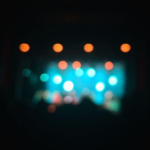 Defocused live show Disco Lights Defocused Illuminated Red Pattern Lighting Equipment Celebration Light Effect Close-up Disco Ball Disco Dancing Nightclub Glowing Spotted Club Dj Projection Equipment Light Bulb