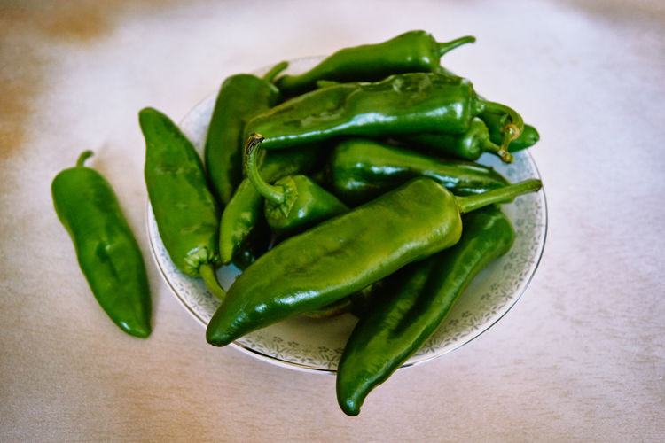 Close-up of green chili pepper on table