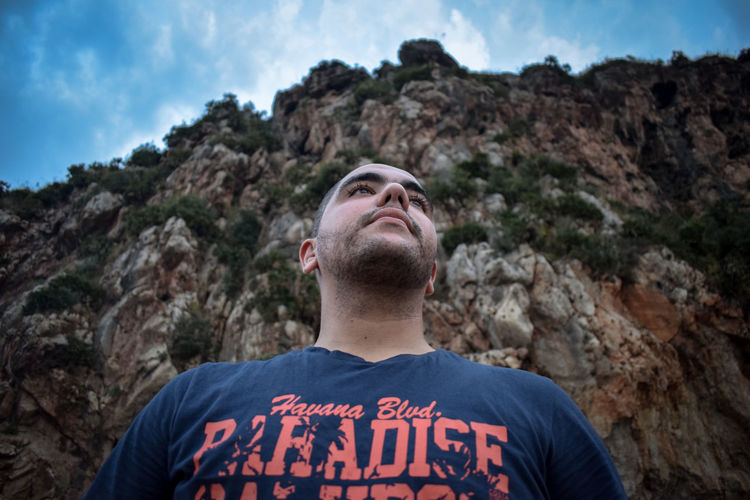 Low angle view of man against mountain