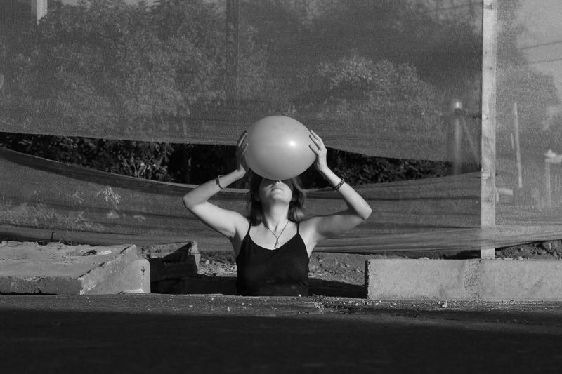 Young woman holding ball