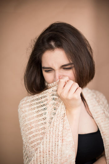 Close-up of woman suffering from cold