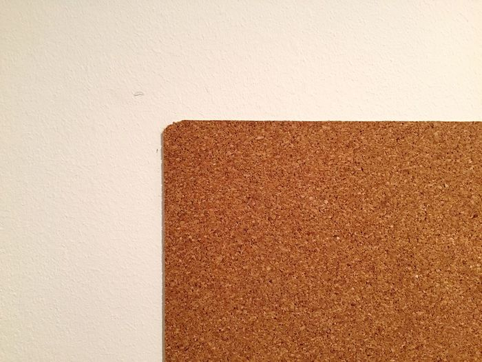 Tilt image of paper on wall