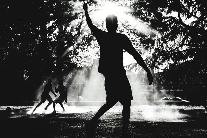 Fight, ©2017 Black&whiteSilhouette Sport Motion Streetphotography Blackandwhitephotography Men Leisure Activity Adults Only Outdoors People Adult Sportsman Full Length Real People Tree Day One Person Athlete Sky Gettyimages Getty X EyeEm Getty Image-collection Getty Images Streetphotograph