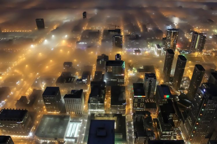 Glowing streets of Chicago Illuminated Night City Building Exterior No People Architecture Built Structure Cityscape Building Cloud - Sky High Angle View Modern Glowing Sky City Life Skyscraper Outdoors Lighting Equipment Financial District  Chicago Architecture City Cityscape Aerial View Foggy