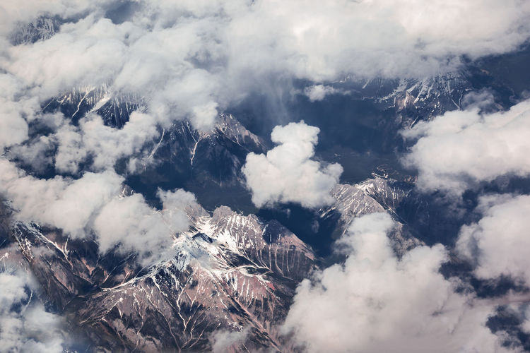 Low angle view of snow covered clouds against sky