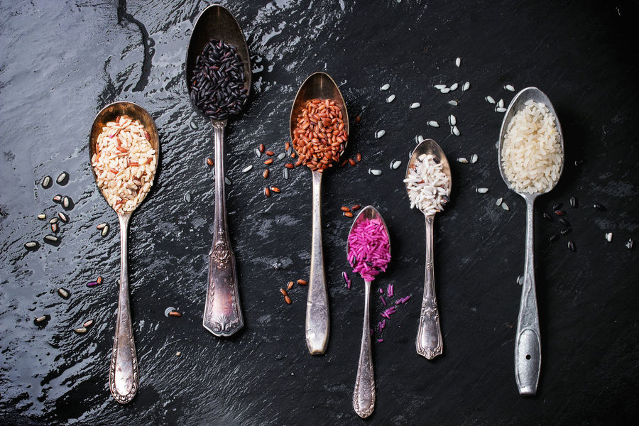 Set of unusual rice in vintage spoons over dark surface. Top view Asian  Assortment Black Background Black Rice Brown Rice Different Food No People Rice Spoon Spoons Studio Shot Uncooked Variation Variety White White Rice