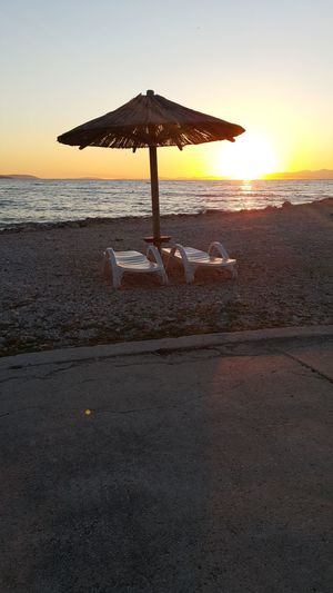 Holiday Beach Sea Sunset Water Vacations Horizon Over Water Summer Tranquility Silhouette Pair Of Chairs Sunchair