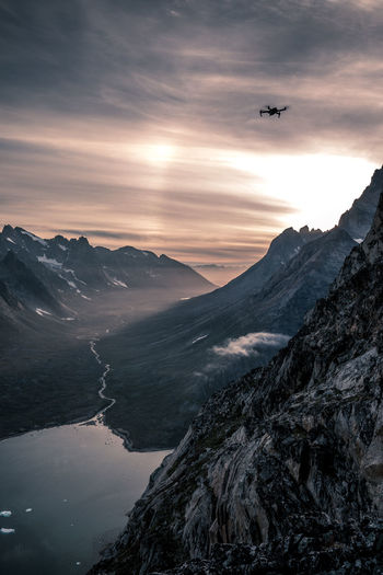 Drone  Greenland Air Vehicle Airplane Airplane Wing Beauty In Nature Cloud - Sky Day Flying Landscape Mid-air Mountain Mountain Range Nature No People Outdoors Scenics Sky Sunset Transportation Fresh On Market 2017