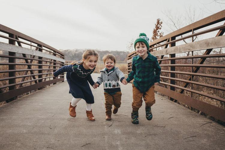 Full length portrait of boys friends